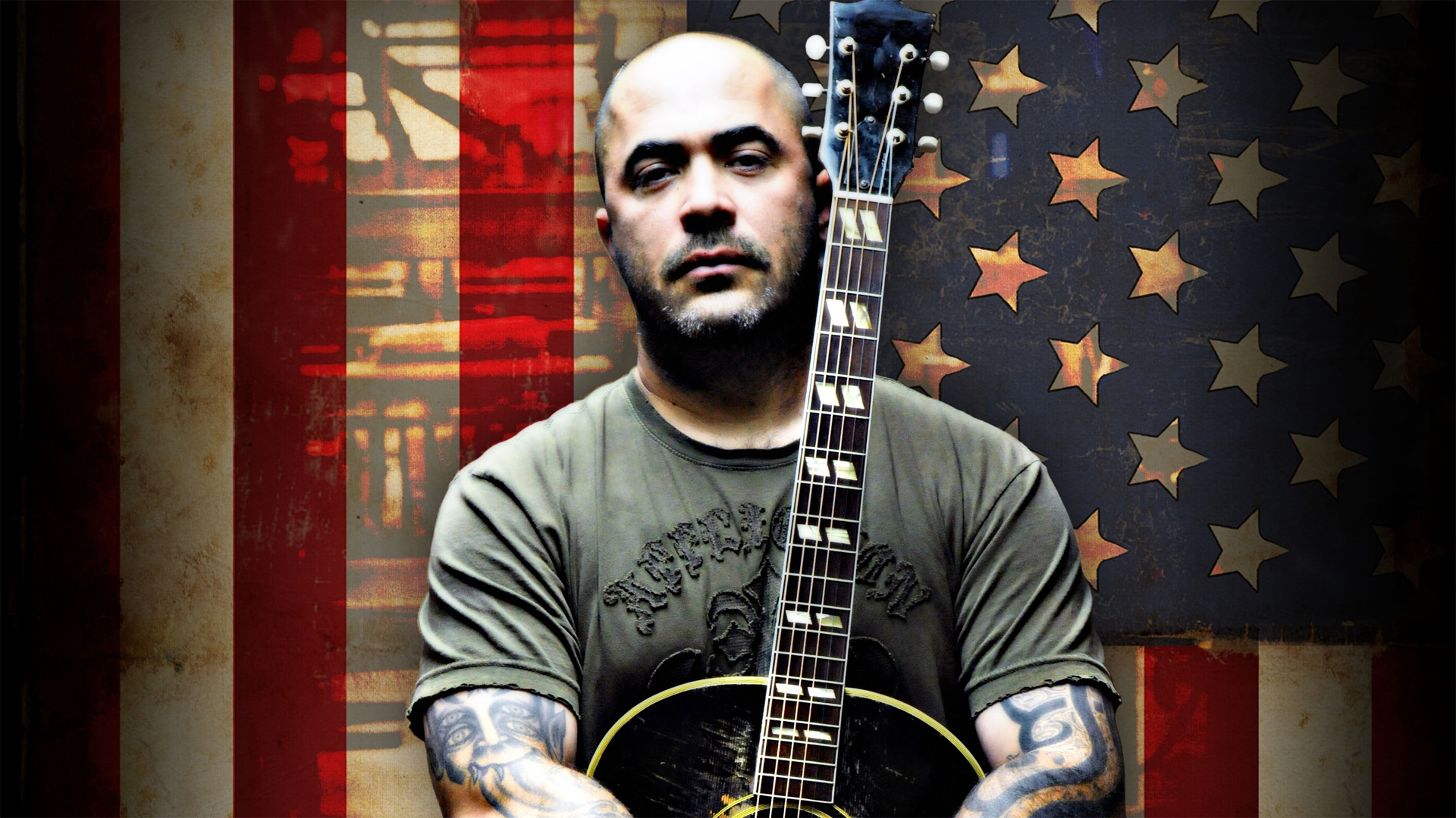 download wallpaper 1920x1080 aaron lewis guitar bald tattoo flag full hd 1080p hd background. Black Bedroom Furniture Sets. Home Design Ideas