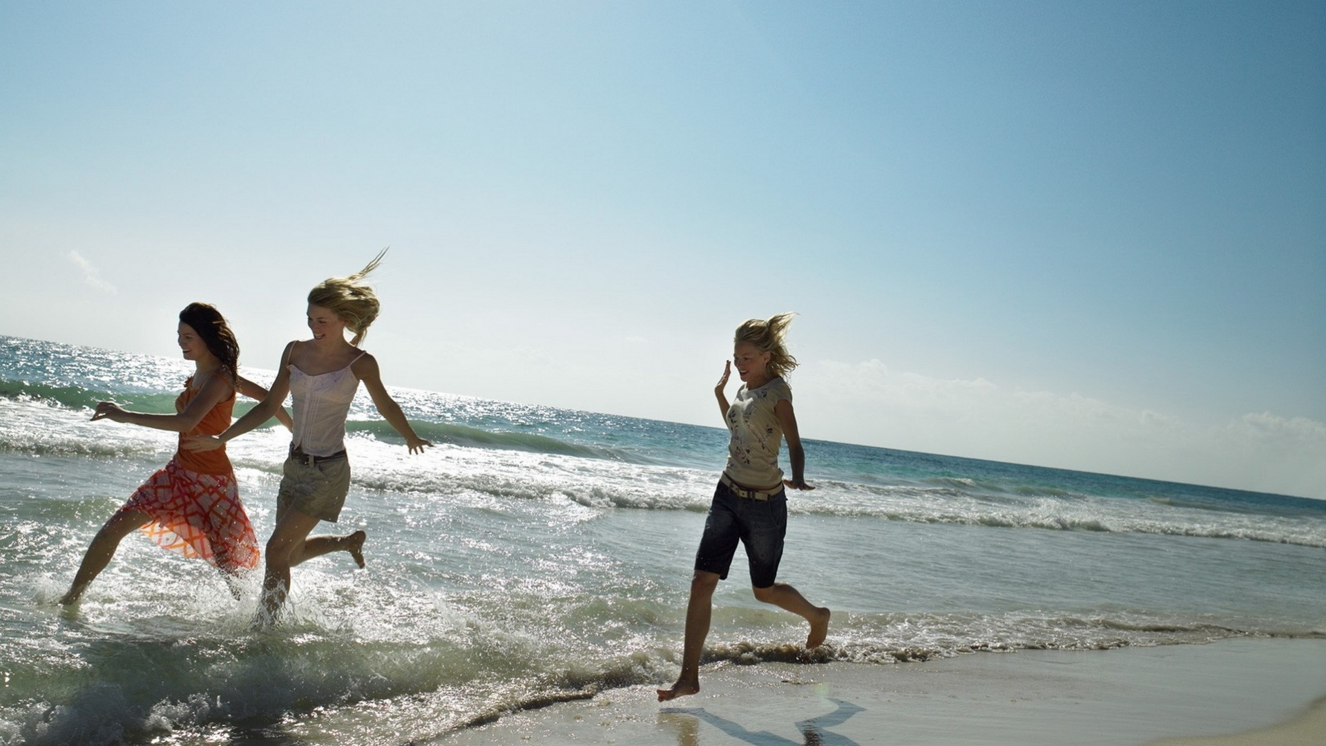 download wallpaper 1920x1080 girls, beach, sea, running, sand full