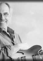 larry carlton, grey-haired, smile
