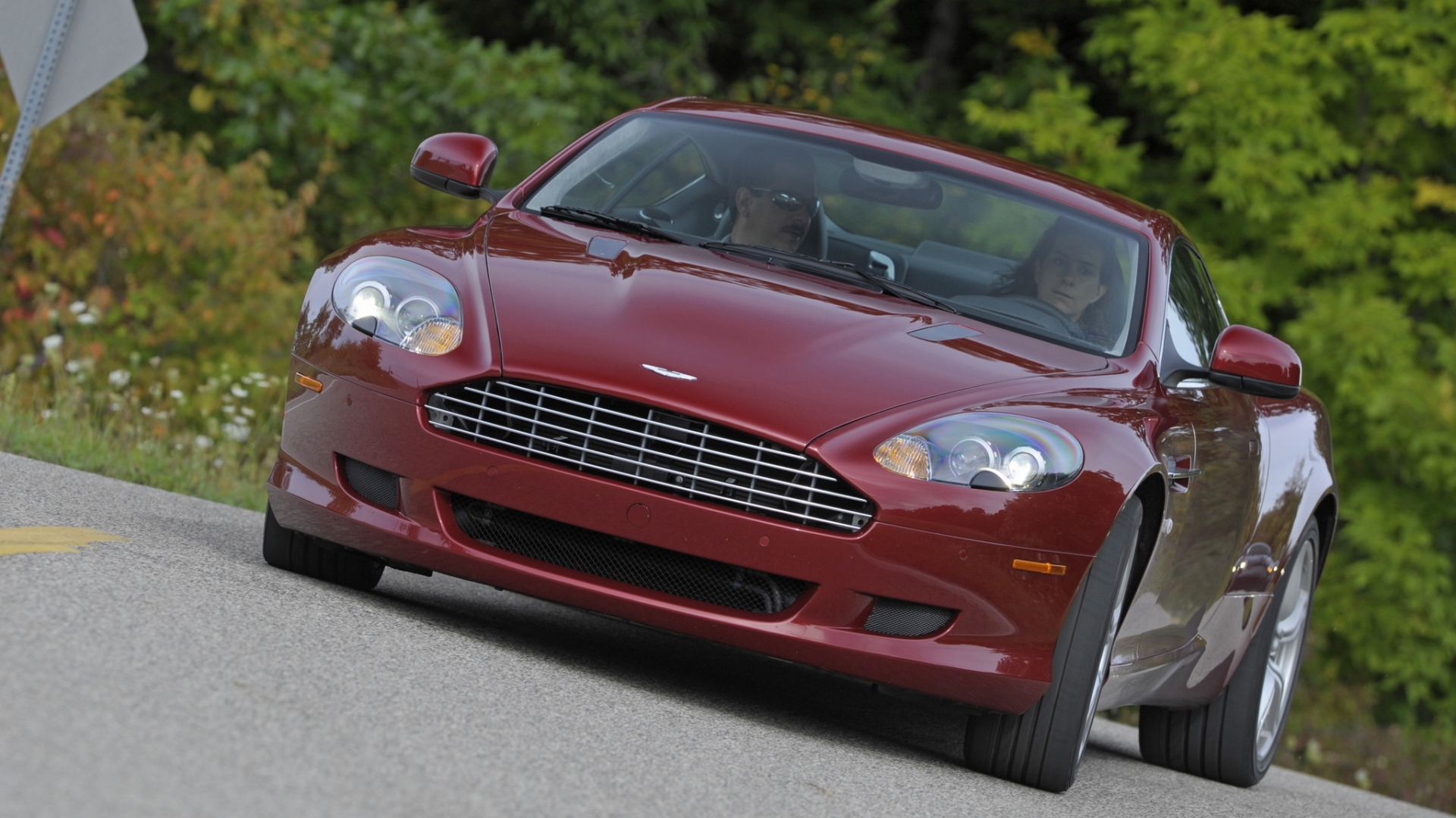 Download Wallpaper 1920x1080 Aston Martin Db9 2008 Red Front View Style Cars Nature Trees Grass Mark Full Hd 1080p Hd Background