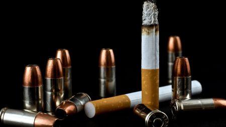 bullets, cigarettes, dark background