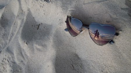 glasses, sand, reflection