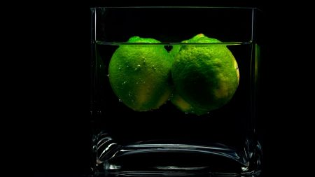 limes, glass, water
