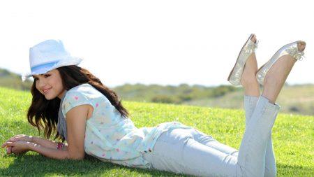 selena gomez, grass, lie