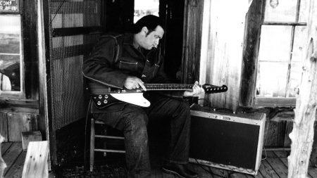steven seagal, guitar, chair